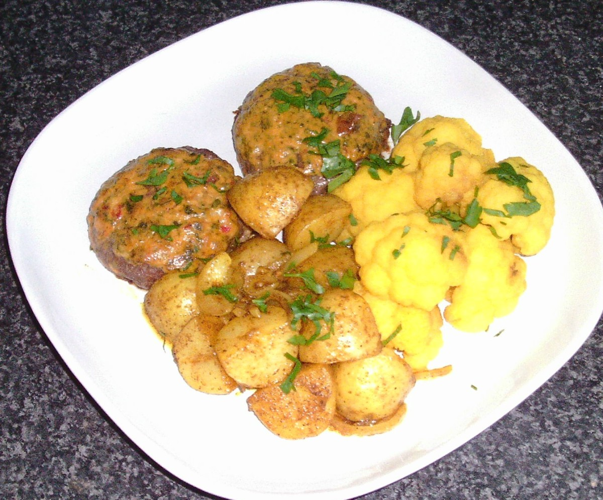 Turmeric infused cauliflower with hot and spicy habanero venison burgers and curried potatoes