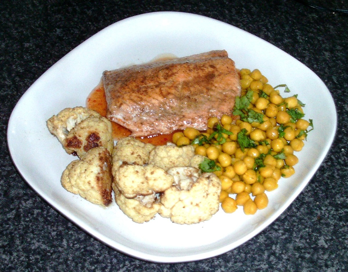 Cumin and coriander spiced oven roasted cauliflower with spicy pan fried salmon and chickpeas