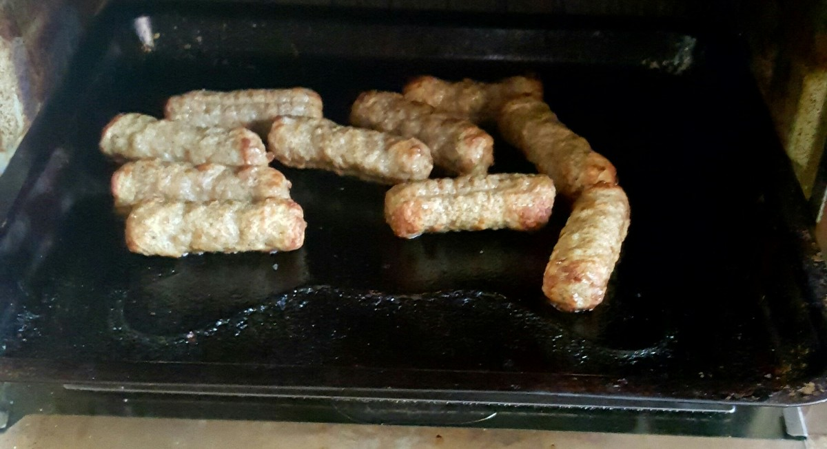 Sausage heating up in the oven.