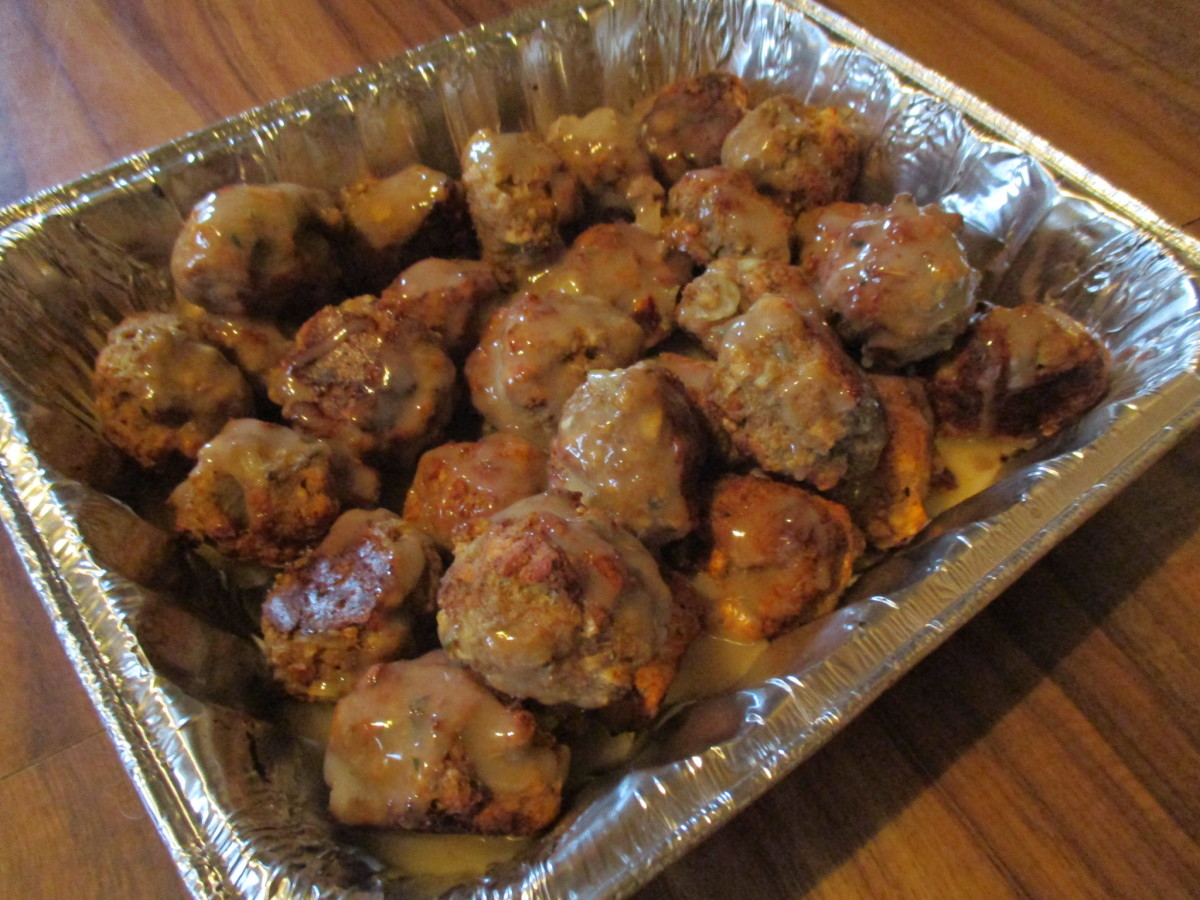 Meatballs with gravy on them.