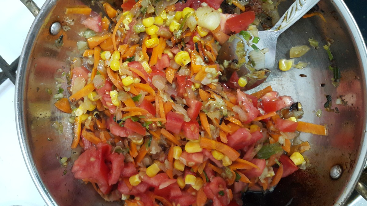 Tomatoes added to the vegetable mixture. Cook them for 2-3 minutes.