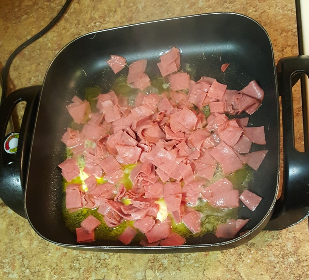 Add beef squares to skillet.