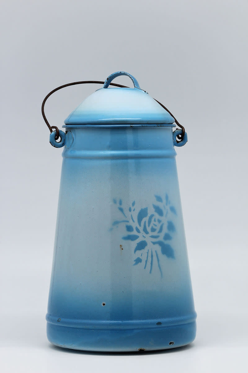 Old blue enameled milk can