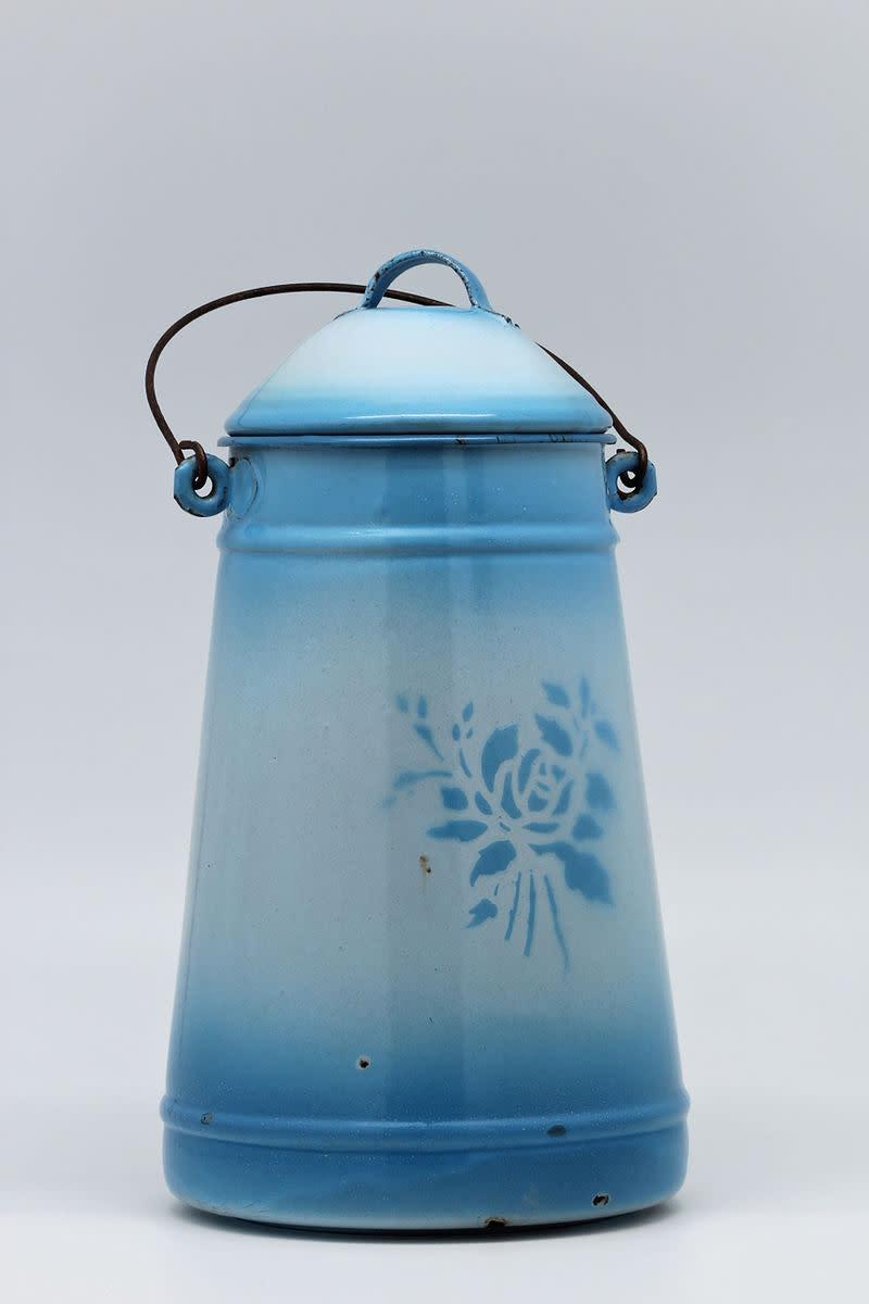 Old blue enameled milk can