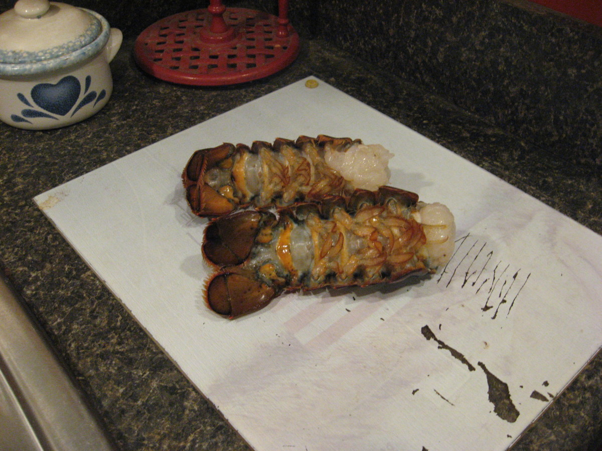 Rinse and dry the lobster tails and place them on a cutting board.
