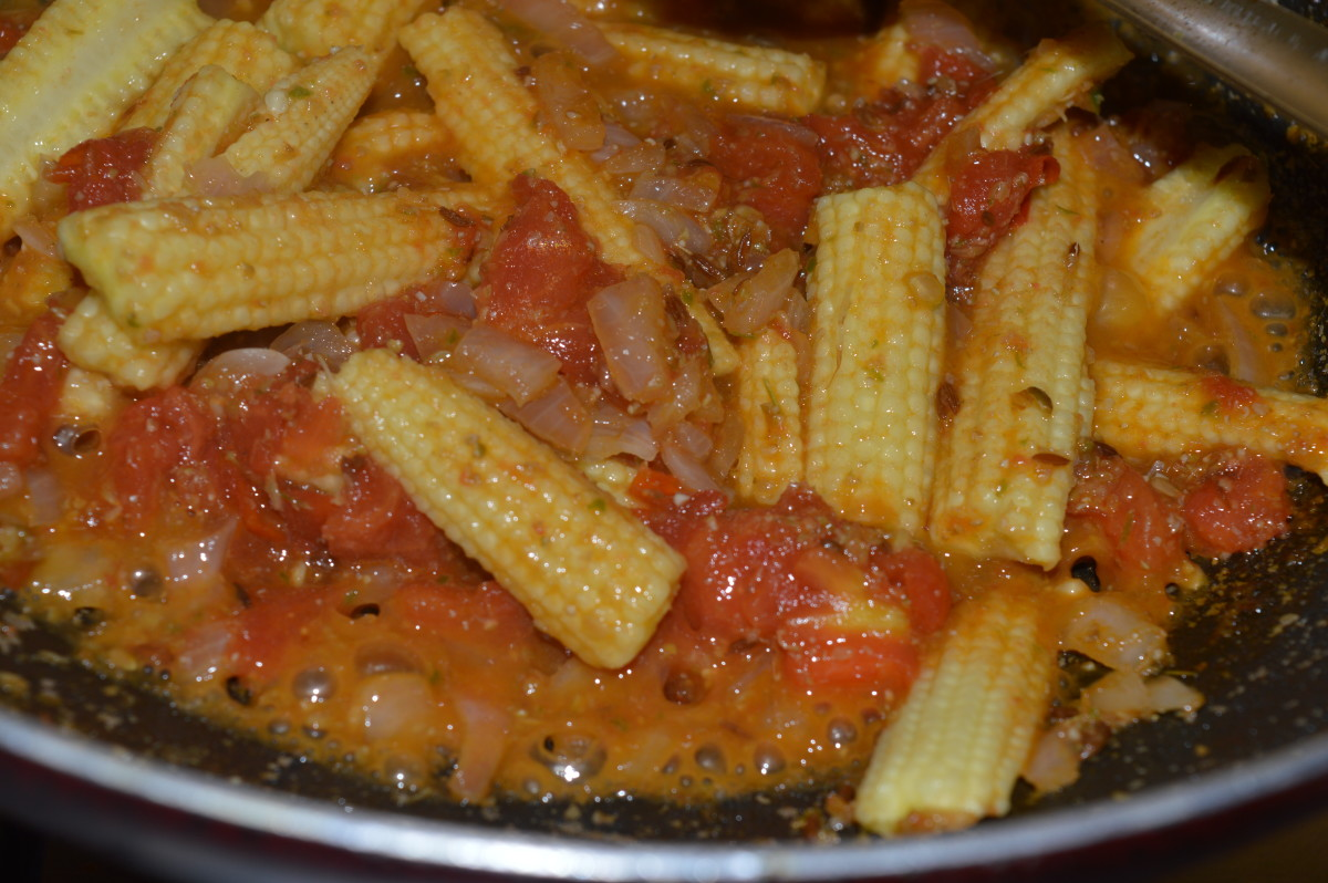 Cook the baby corn in the tomatoes and onions.