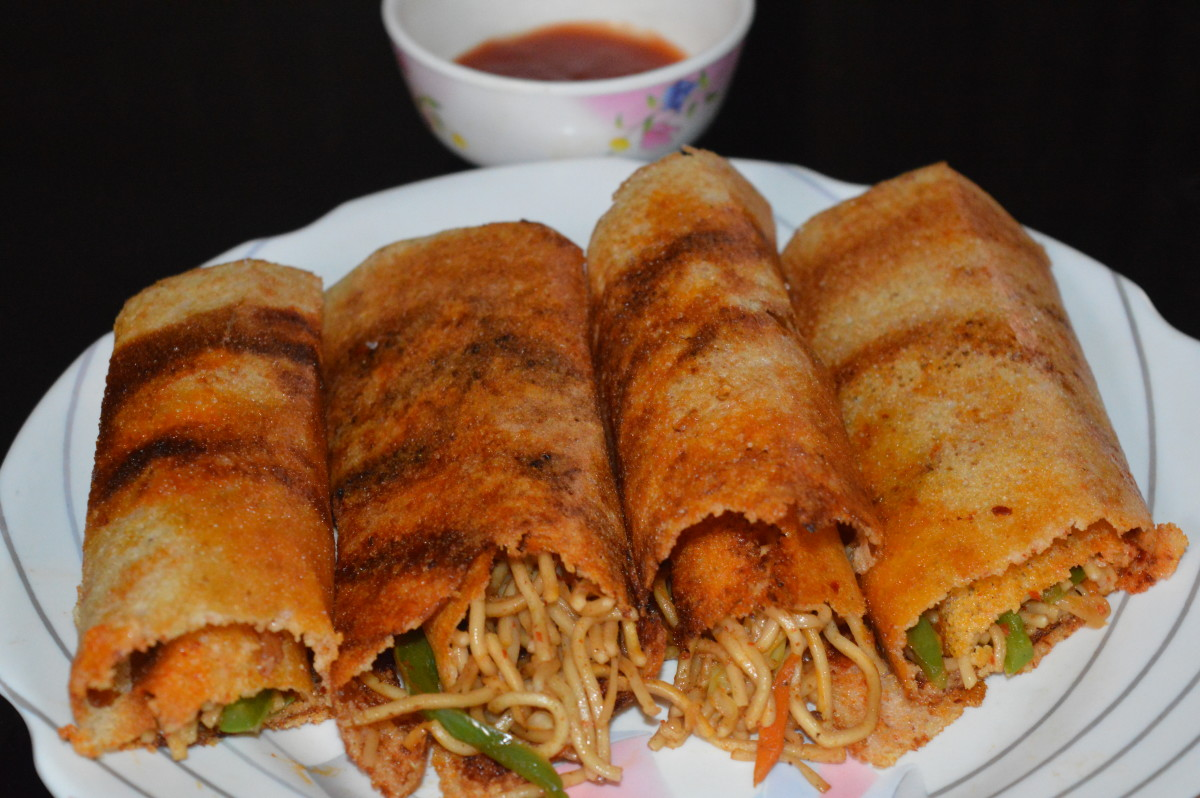 Dosa gets bright golden brown color due to the szechuan sauce applied inside. Serve schezwan dosa with tomato sauce