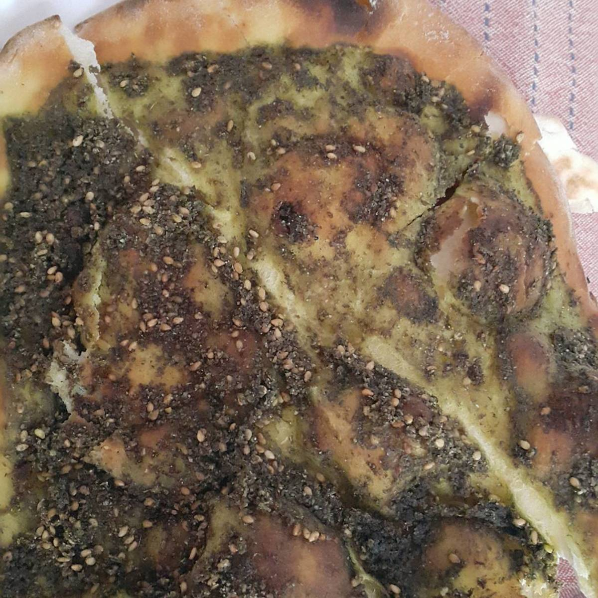 Fatayer Za'atar is a pizza like crust sprinkled with a generous amount of a herb called za'atar.