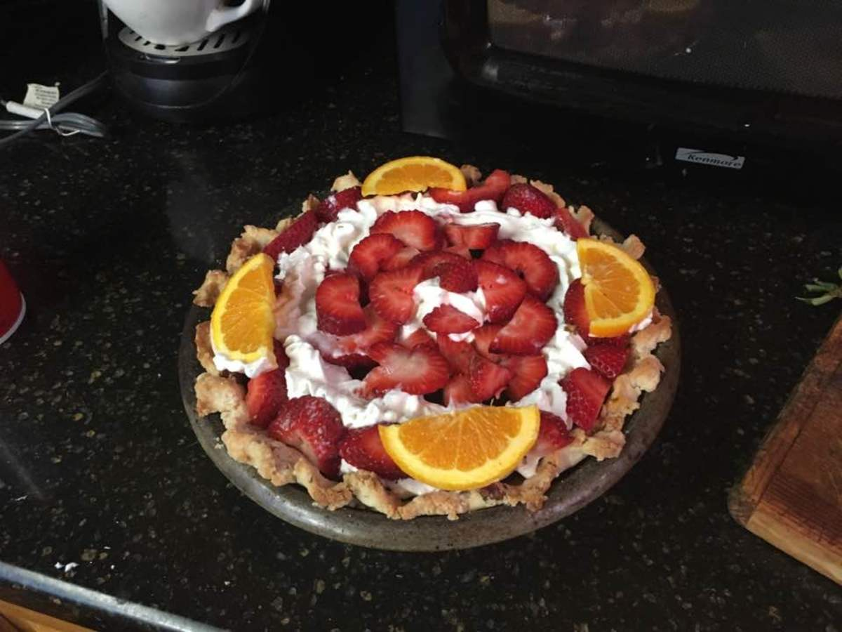Covered with whipped cream, strawberries, and oranges, it makes a beautiful and elegant dessert