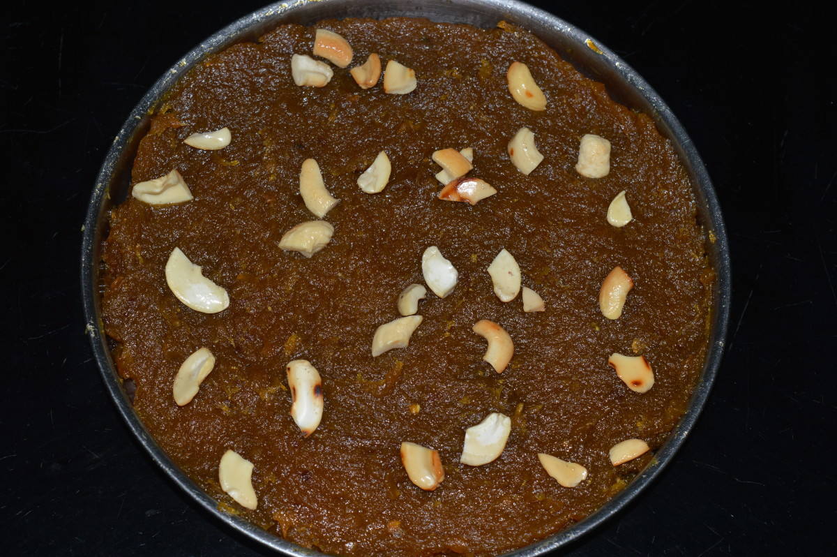 Step five: Pour the halwa into a greased plate. Keep aside for cooling. Garnish it with cashew nuts. Cut it in desired shapes.