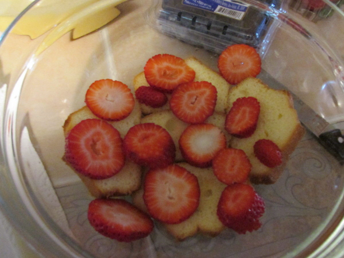 Cake sprinkled with vodka and toped with strawberries