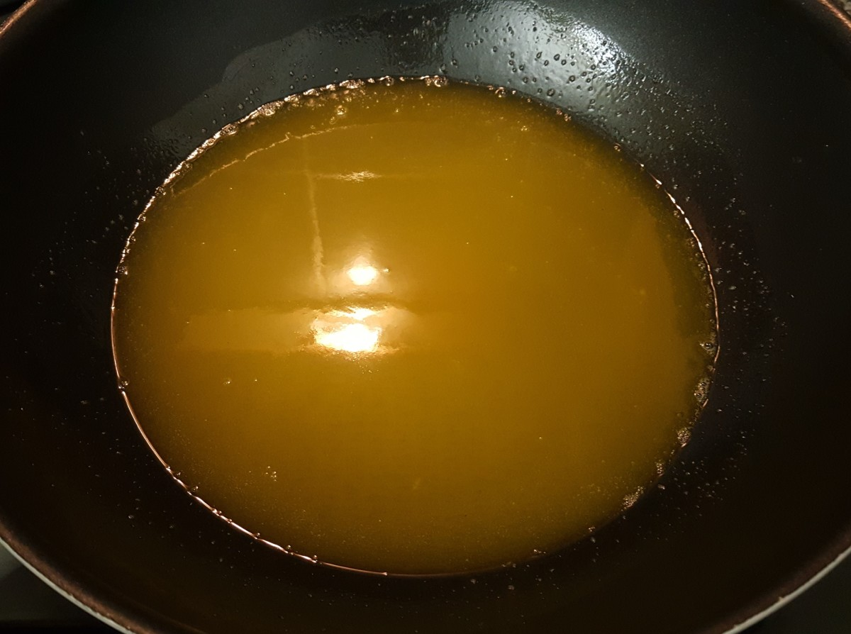 Melt the mixture over medium heat, stirring well until the sugar has dissolved completely