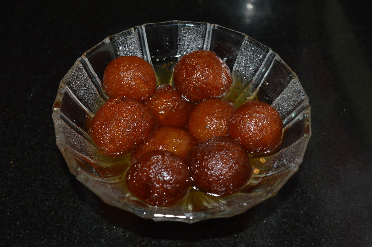 Step nine: Serve warm gulab jamun in a steel or glass bowl. Enjoy eating!