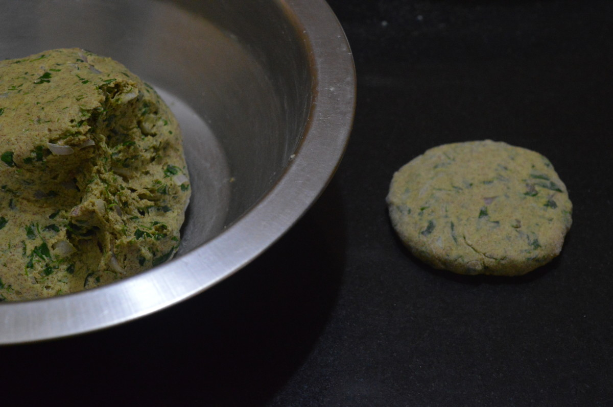 "Step four: Pinch out a lemon size dough. Form it into a patty. Roll it to get a thick disc of about 6 "" diameter."