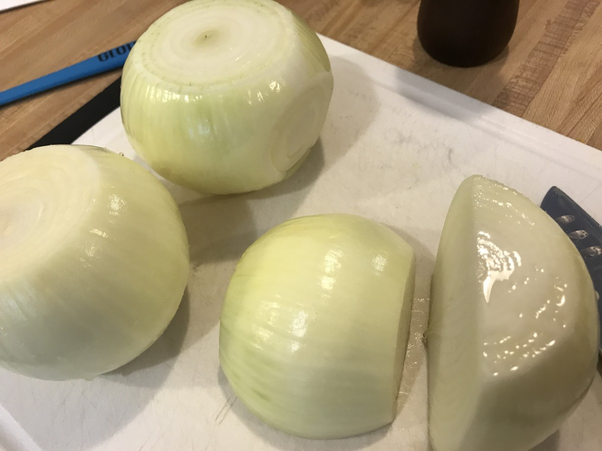 You can use any cut of onion for caramelizing, but the most traditional is slices. Cut the onions in half after peeling it to get started.