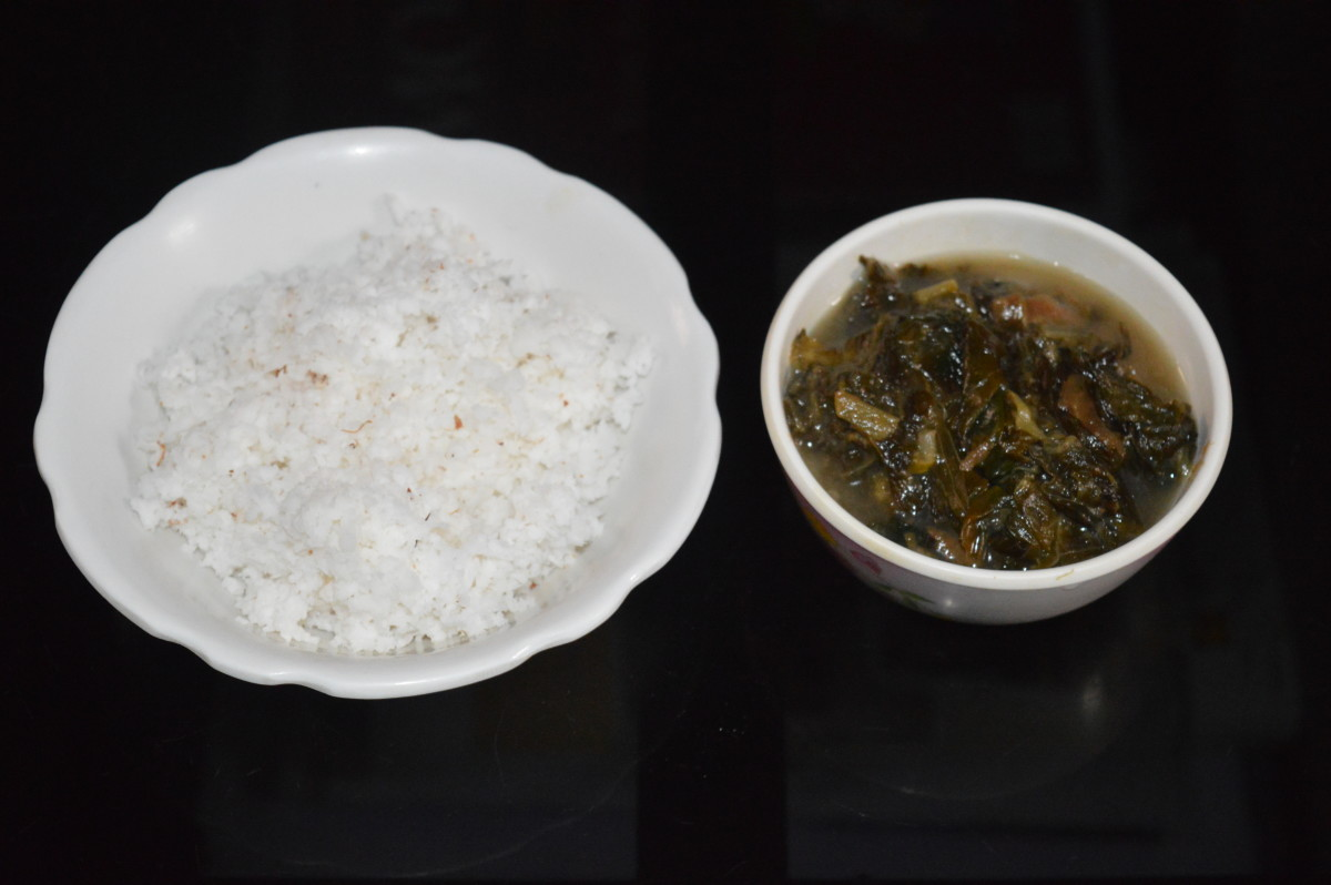 Grated coconut and cooked taro leaves