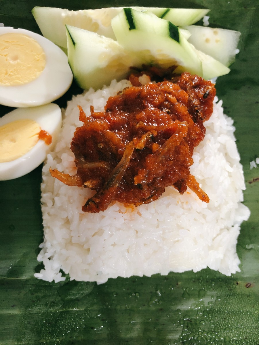Assemble the sambal ikan bilis on top of the rice, hard-boiled eggs, and fresh sliced cucumbers. Serve in on top of banana leaf for the best and most authentic nasi lemak.