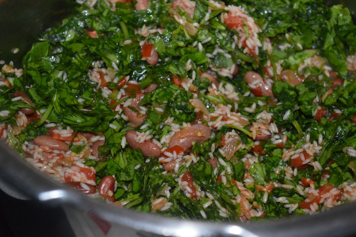 Mixing and cooking the spinach.