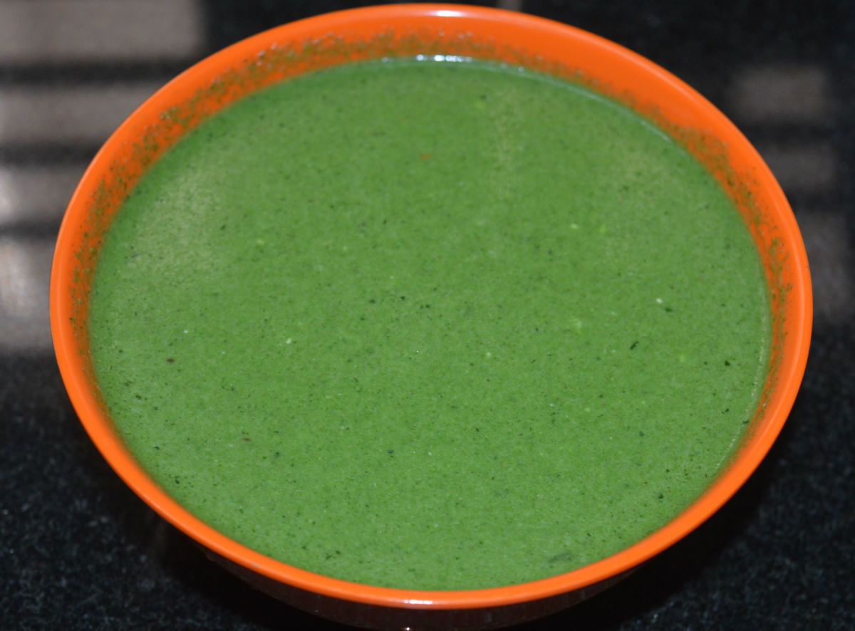 Step six: If you are using it as a side dish, keep it thick; if you want to drink, make it thin by adding water. Adjust salt.  Moringa leaves beverage is ready!