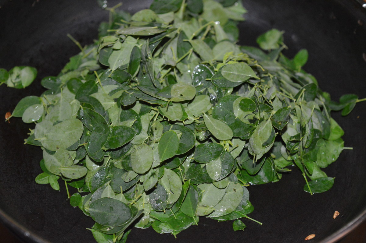 Step two: Add washed moringa leaves. Continue sauteing on a low fire for 6-7 minutes or until the leaves become tender and soft.
