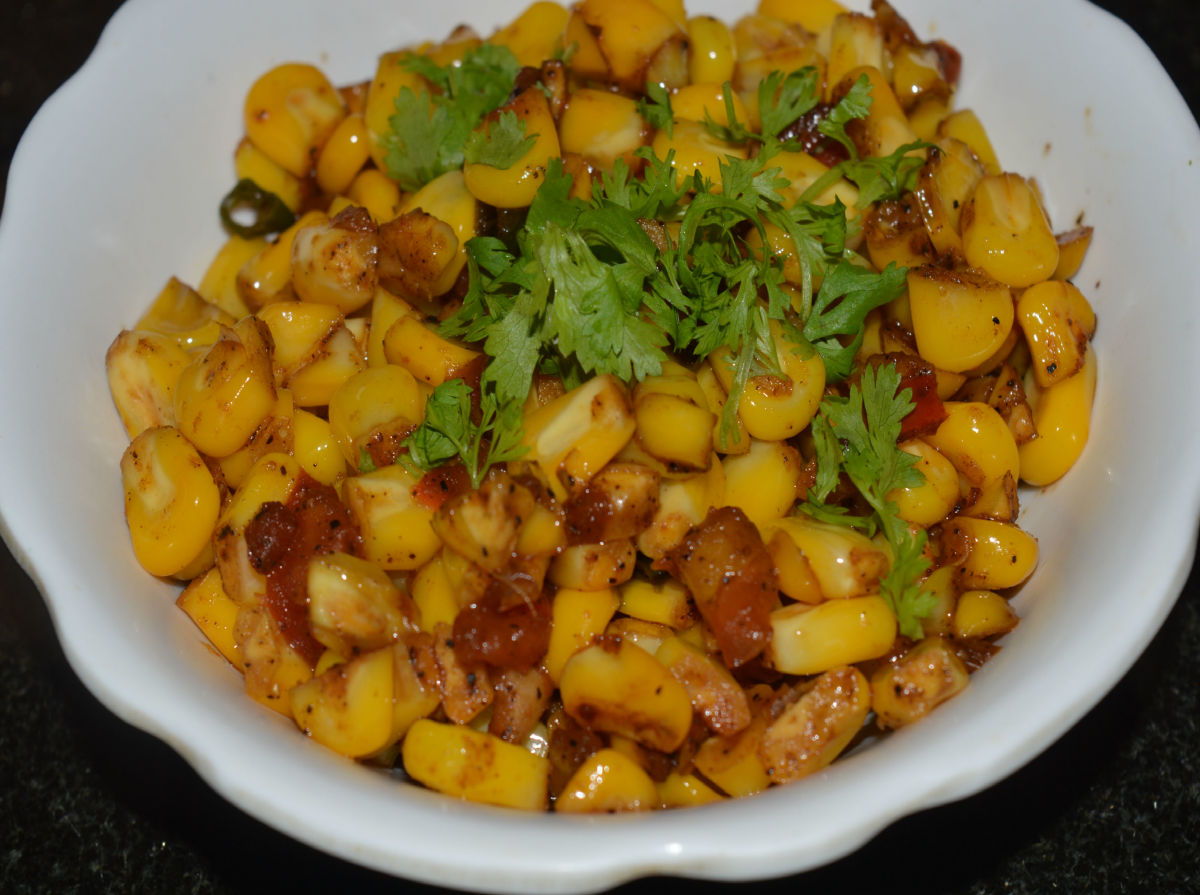 Crunchy and yummy sweet corn stir-fry is ready to eat ! Serve them garnished with finely chopped coriander leaves. Enjoy munching them.