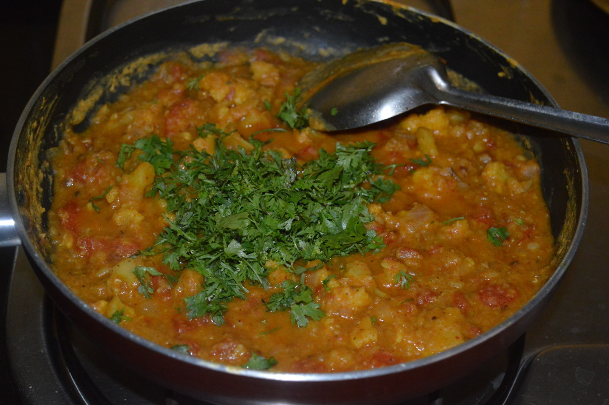 Step seven: Throw in finely chopped coriander leaves. Mix it with the curry.