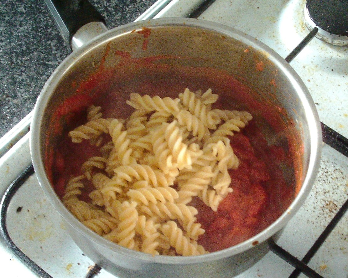 Pasta is added to tomato sauce