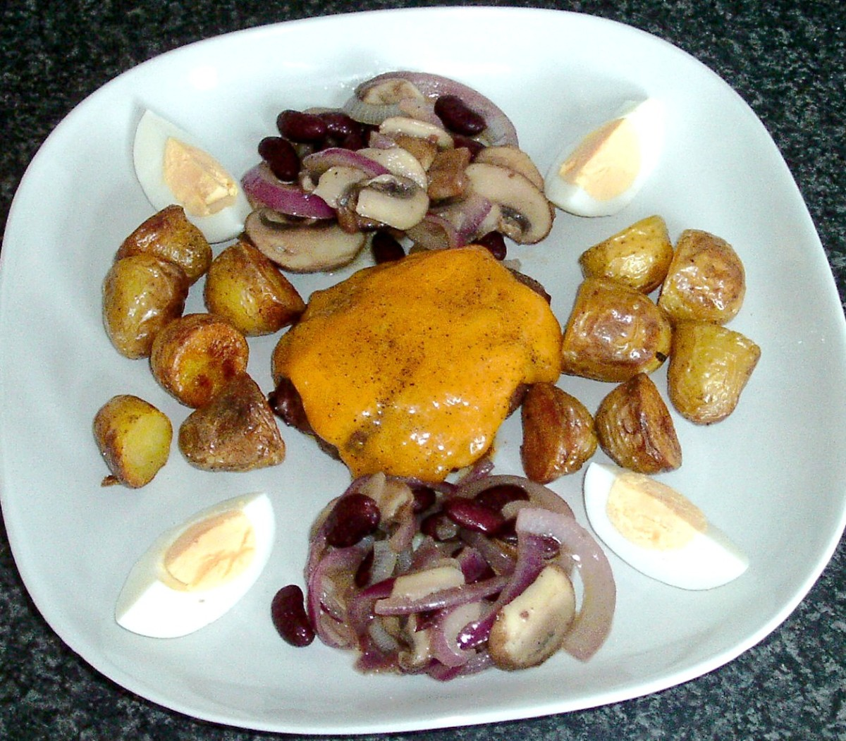 Buffalo and beef cheeseburger with deep fried potatoes and warm bean salad