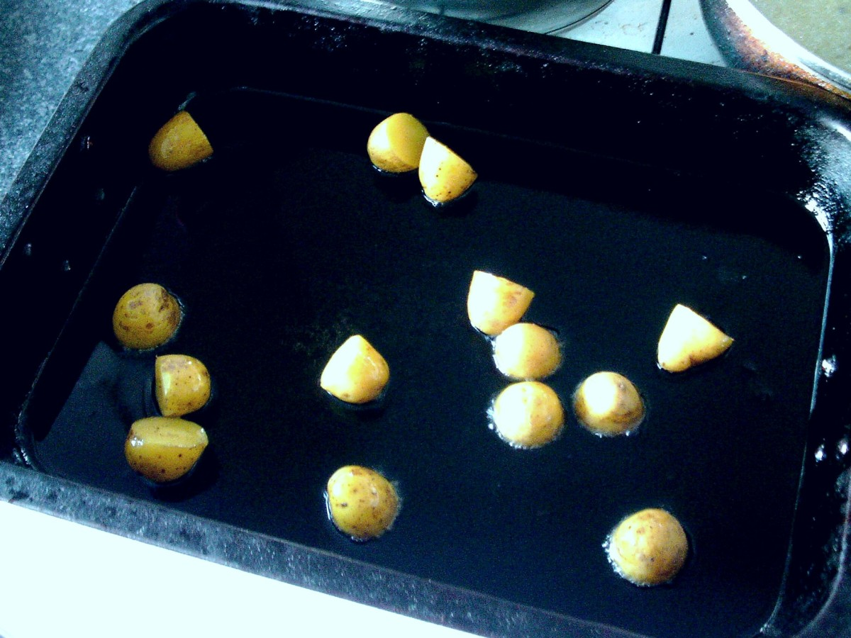 Boiled and cooled potatoes are added to hot oil for roasting