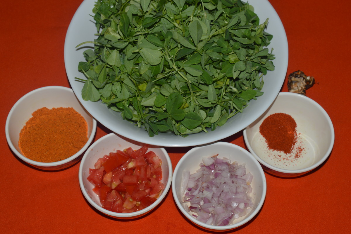 Step one: Keep the ingredients ready. Make a seasoning as per instructions. Saute onions and tomatoes. Add chopped fenugreek leaves. Stir-cook them. Add all other spice powders and salt . Saute for a minute.