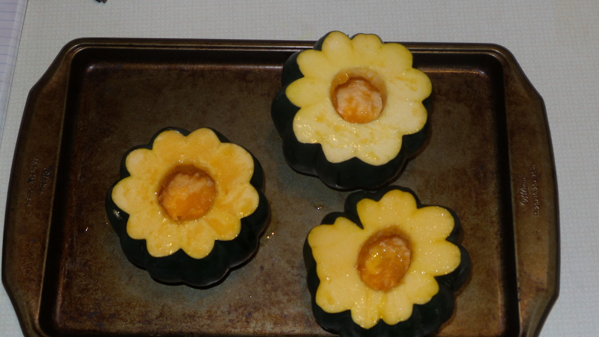Place squash on a baking sheet, drizzle olive oil over the tops