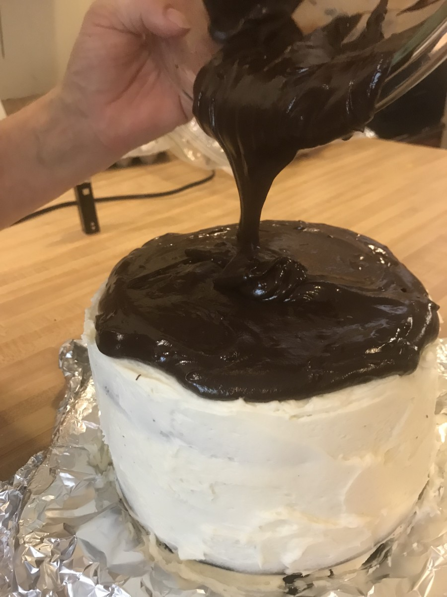 The ganache will pour easily if you use it immediately. Here it is poured over a black velvet cake frosted with simple buttercream.