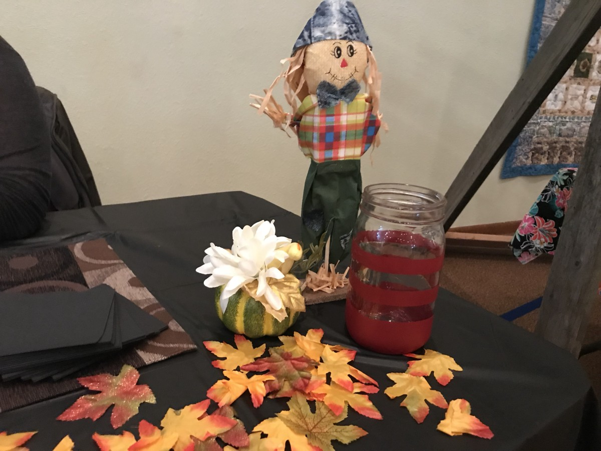 My little scarecrow watching over my ticket jar!