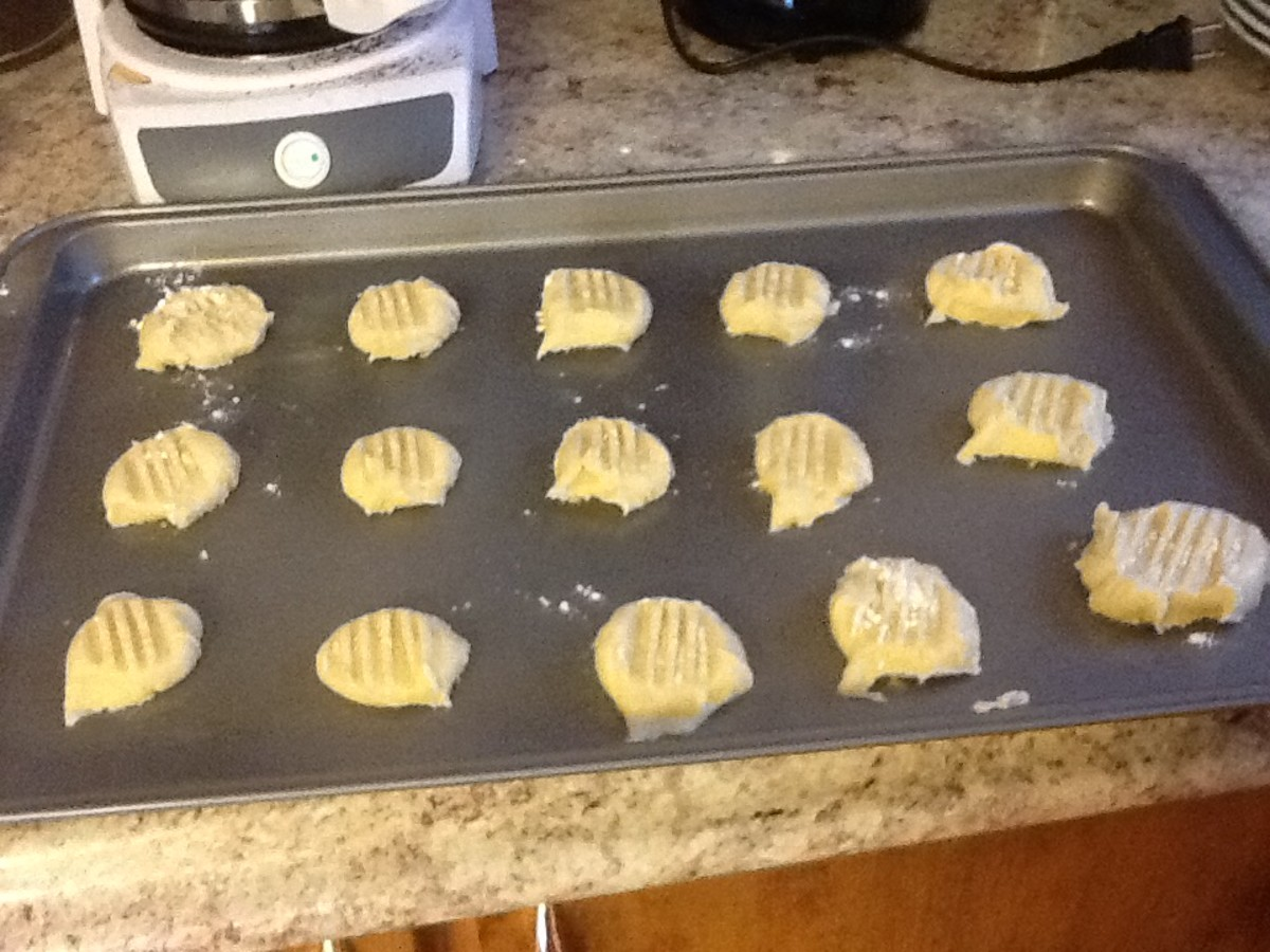 Use a fork to flatten down the cookies.