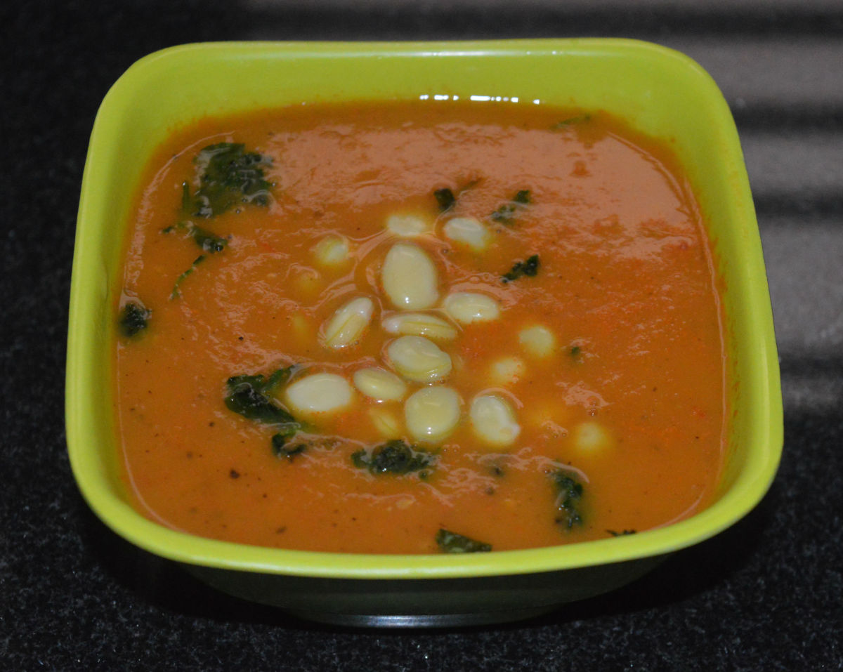Step seven: Pour it equally into four bowls. Add some cooked beans to each bowl. Garnish with sauteed spinach. Now, your favorite bean tomato soup is ready! Serve it hot.