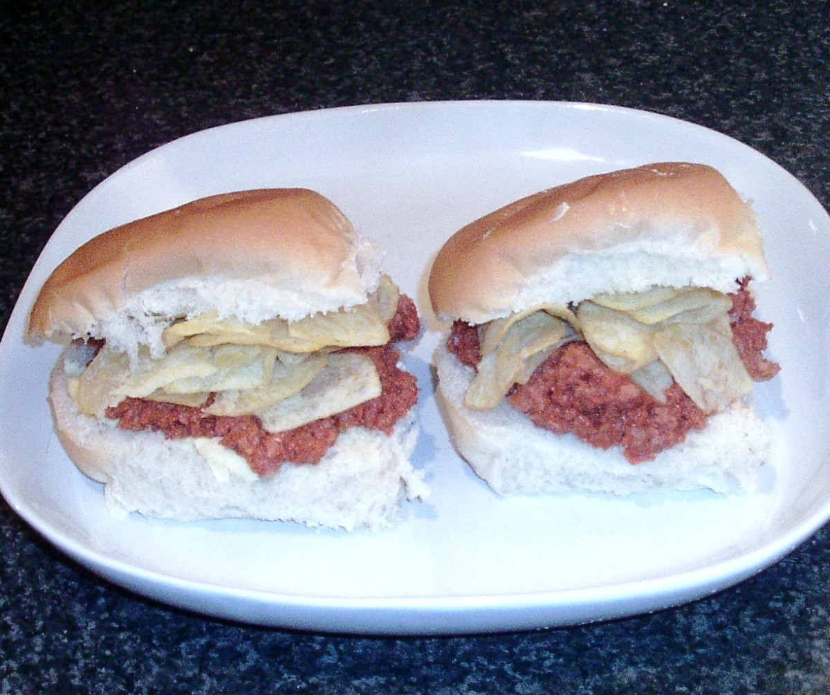 Corned beef mashed in ketchup and chilli with salt and vinegar crisps bread rolls