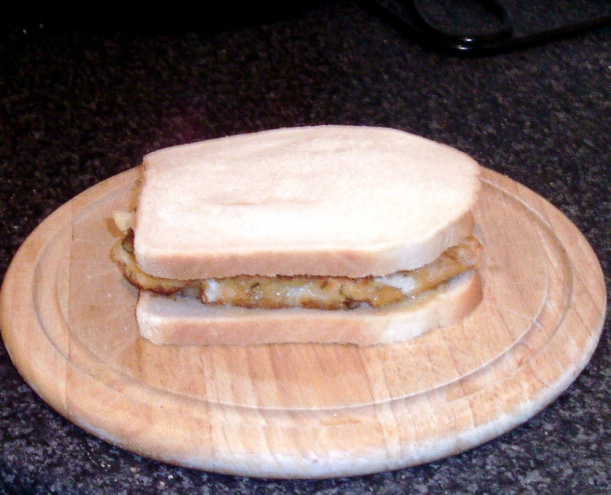 Assembled chicken schnitzel and crisps sandwich