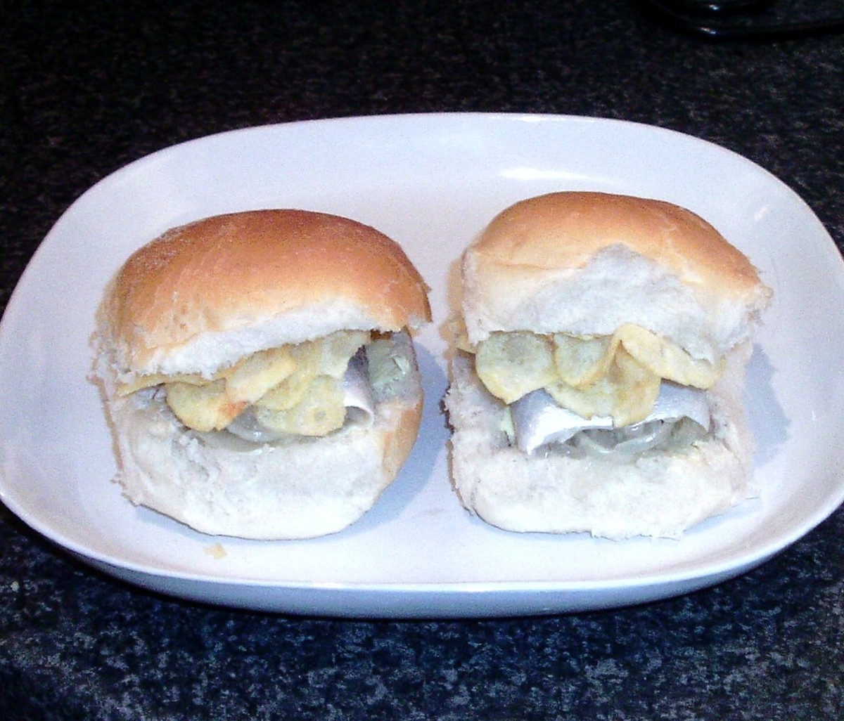 Pickled herring or rollmops with salt and vinegar crisps sandwich