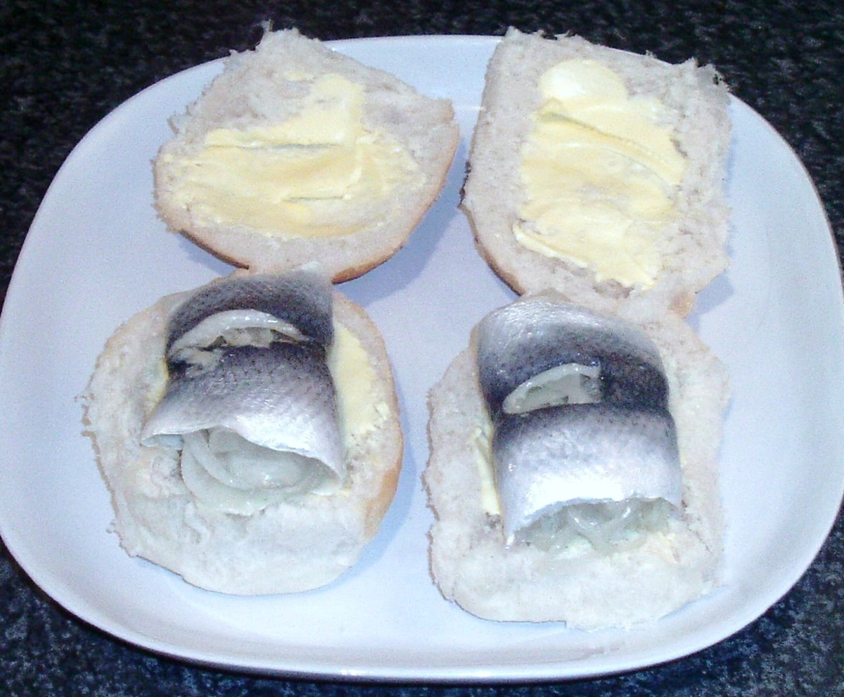 Pickled herring on bread rolls