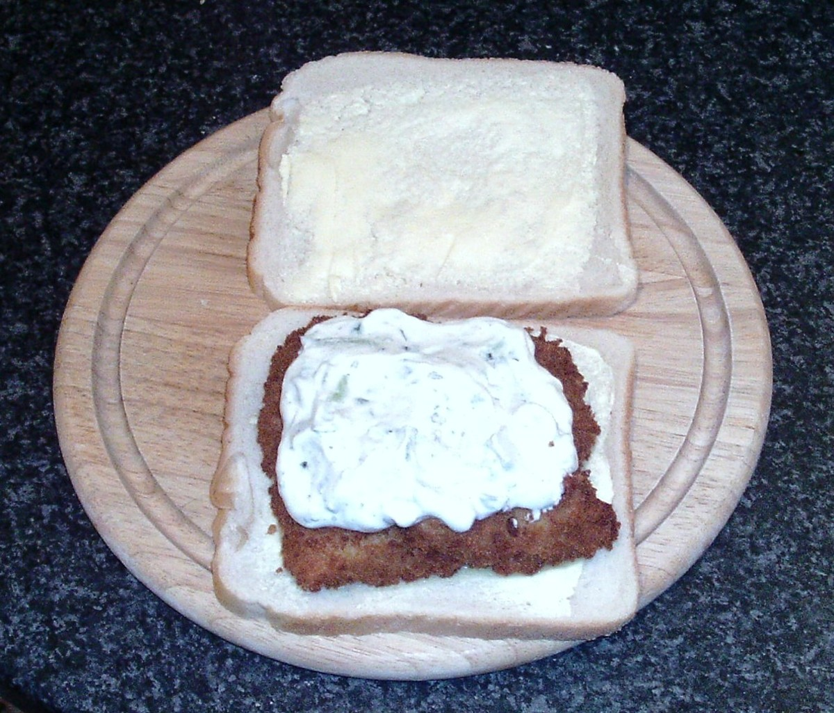 Tzatziki sauce on breaded cod