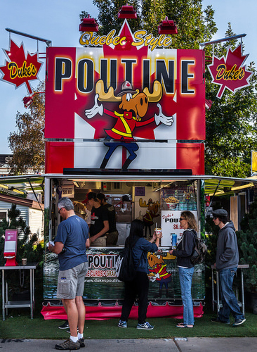 Poutine was definitely invented in rural Quebec; more precise a location cannot be identified.
