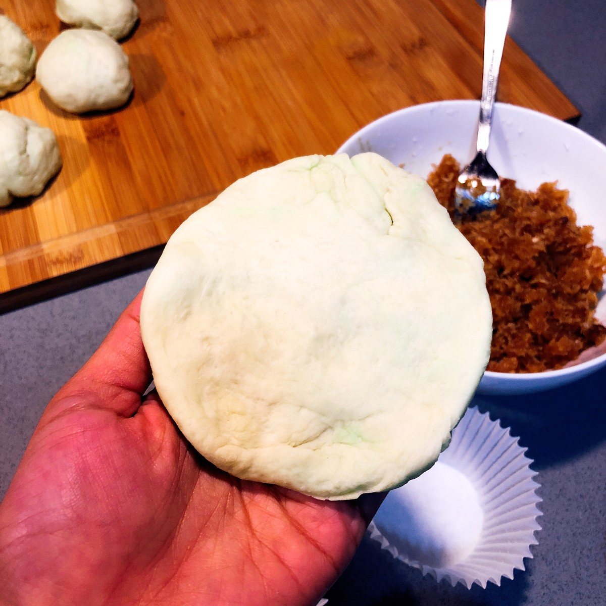 Flatten each dough ball.