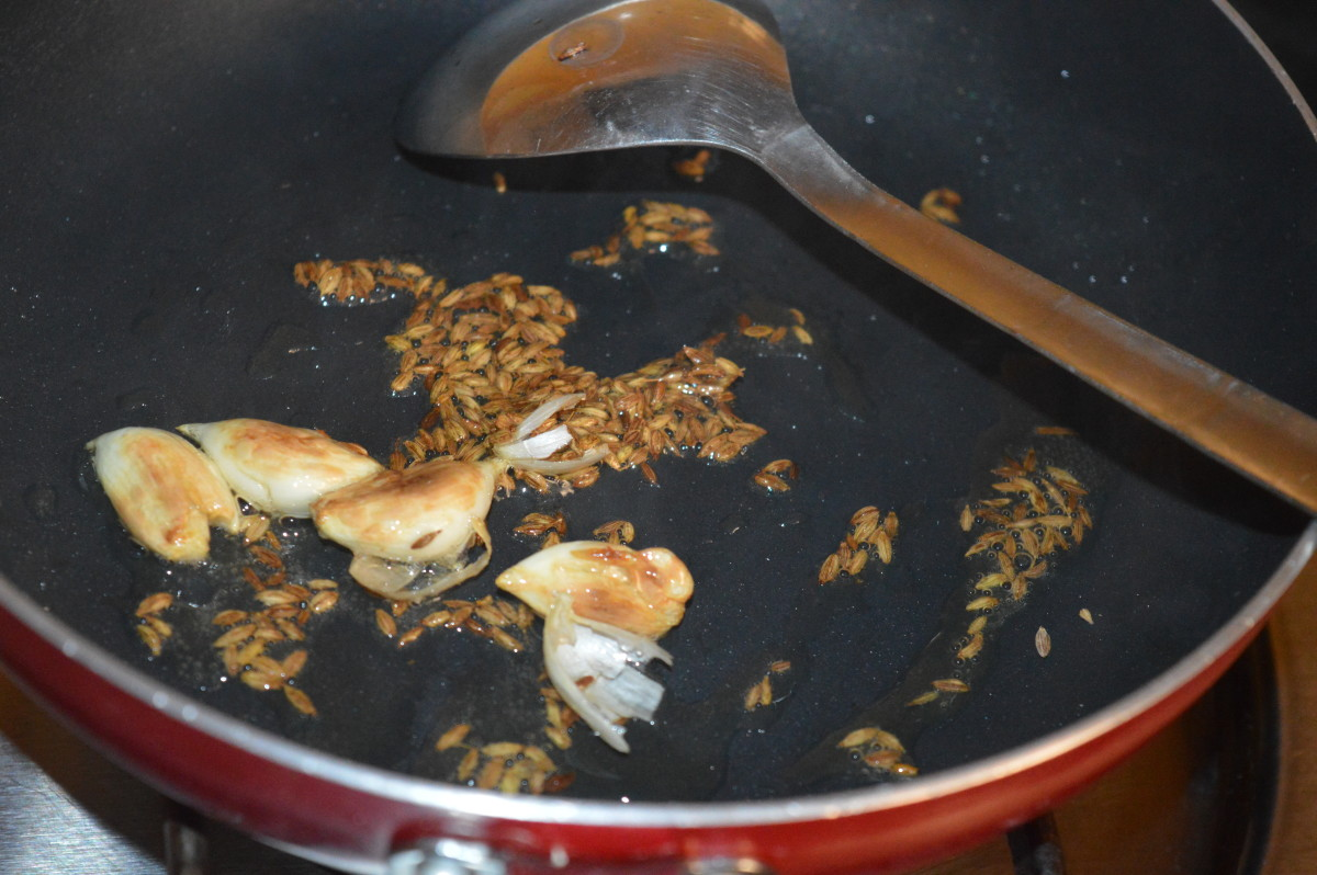 Sizzling the cumin seeds.