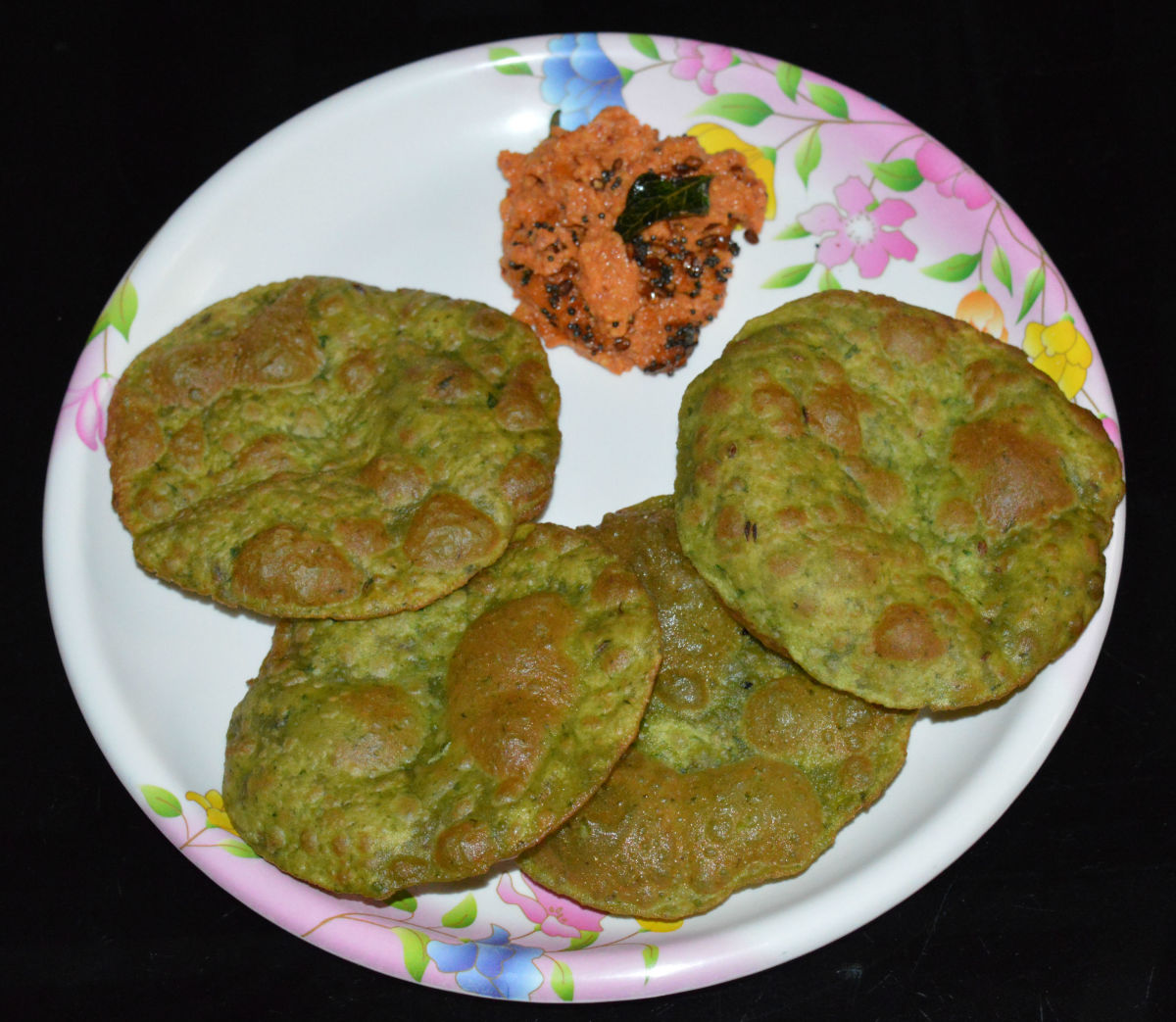 Step four: Serve hot puris with a spicy chutney or with a savory curry/bhaji. Enjoy this delightful combo!
