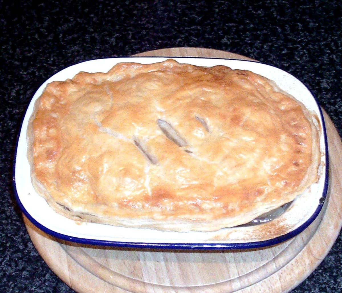 Cooked pie is taken from the oven and set aside to rest