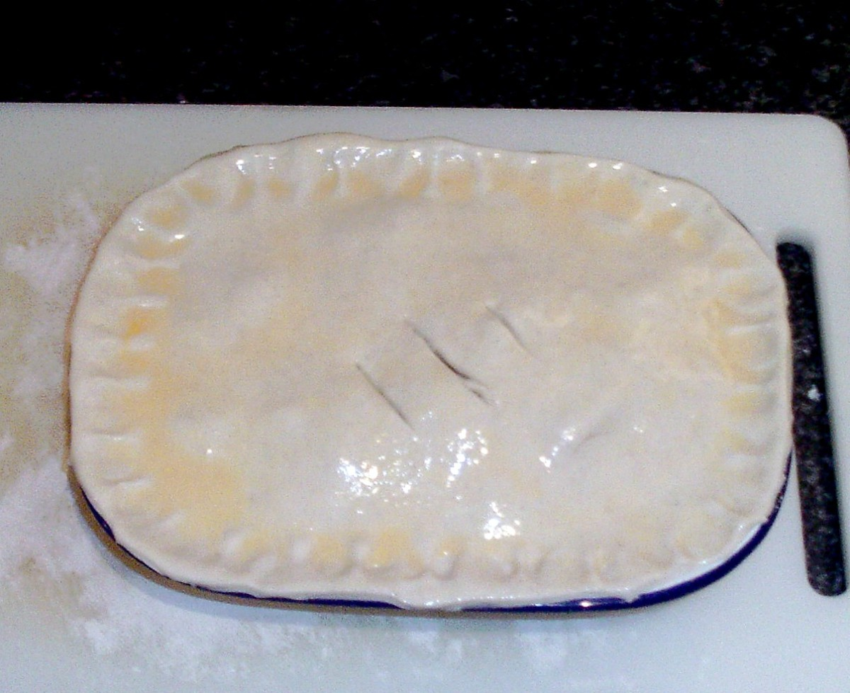 Pie pastry is glazed and ready for the oven