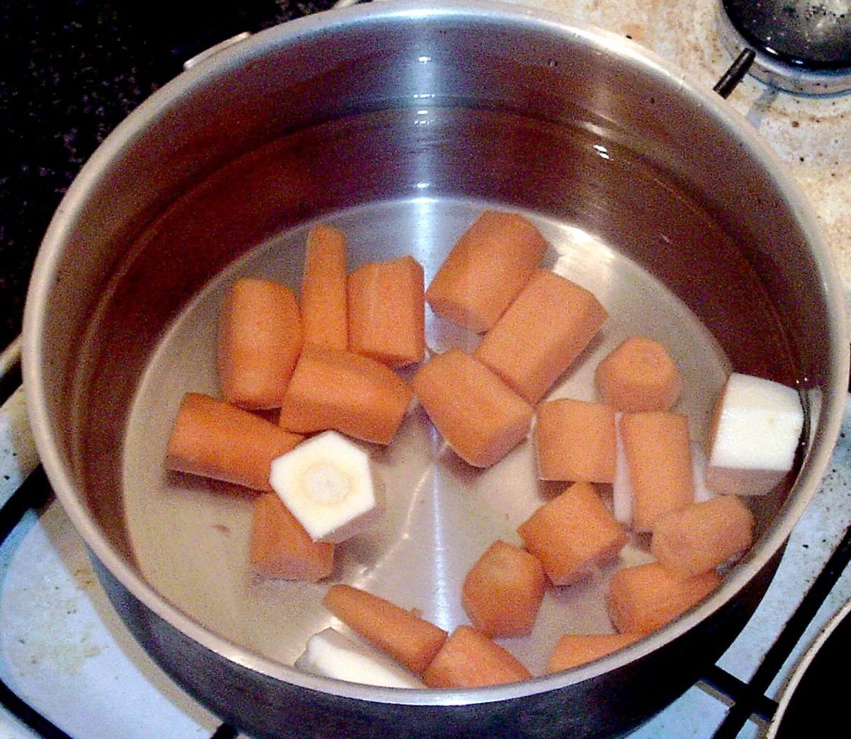 Carrots and parsnips for mash are put on to cook