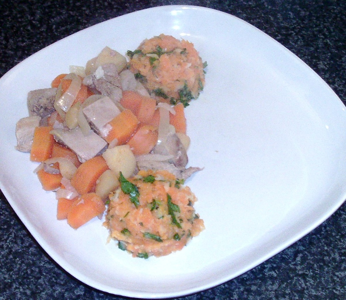 Pie filling is plated with mashed vegetables