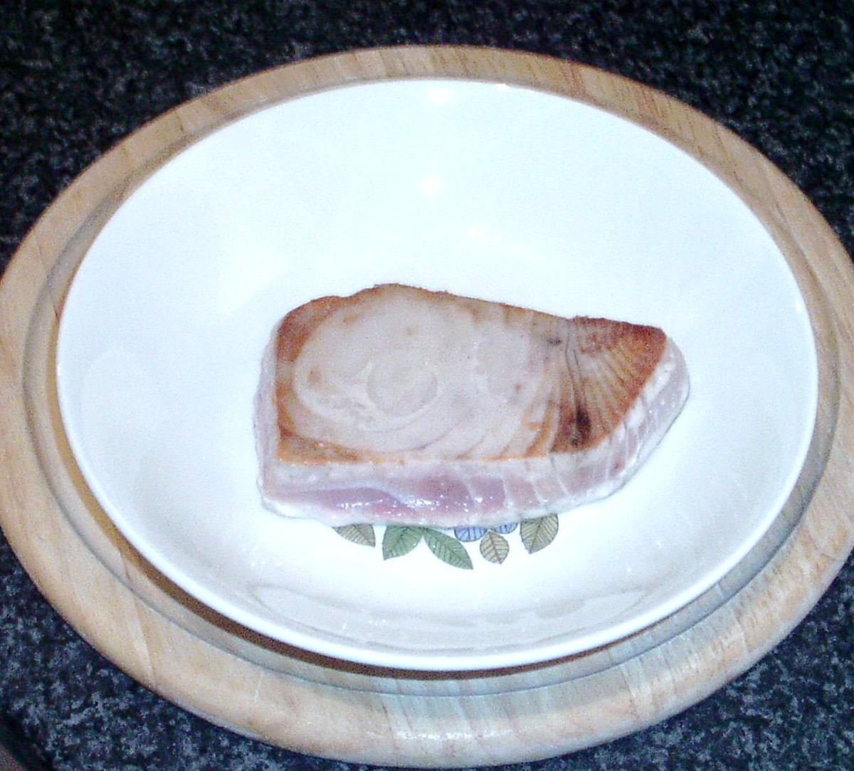 Seared tuna fillet is removed from frying pan