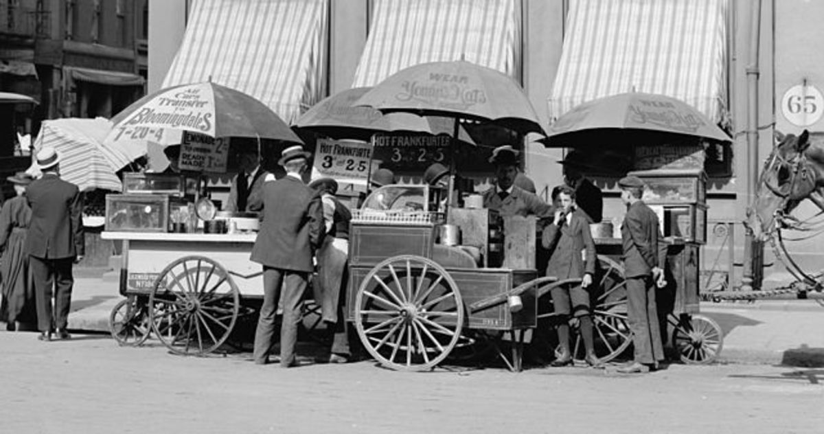 "Carts selling frankfurters in New York City, circa 1906. The price is listed as ""3 cents each or 2 for 5 cents."""
